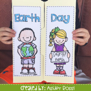 Student holding Earth Day lap book